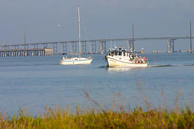 The Danny B on the waters of the Laguna Madra Bay just under the Queen Isabelle Causeway