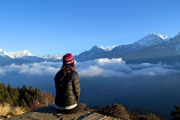 Female travel blogger in the Himalayas