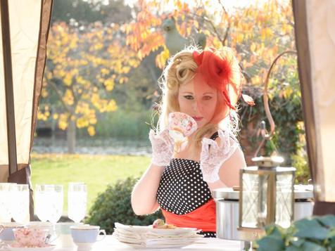 lucie posing cup of tea.jpg