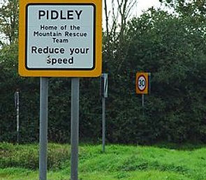 Road Sign for Pidley in Cambridgshire, Home of the Mountain Rescue Team