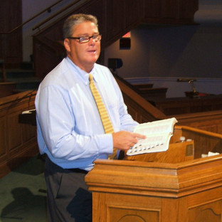 Bart preaching in the pulpit