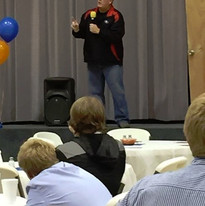 Bart Speaks to football players