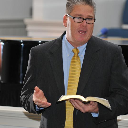 bart preaching in suit.jpg