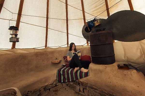 Rocket_Mass_Heater_Inside_a_Tipi.jpg