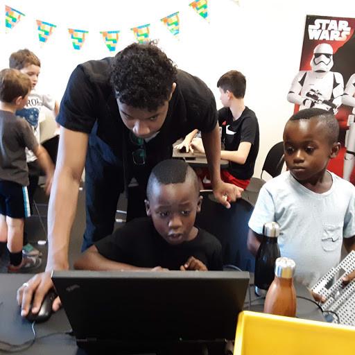 Website - Nathaniel with Kids.jpg