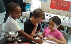 Robotics Camp - 3 Kids Working together.