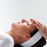 woman-relaxing-at-reiki-session--4801189