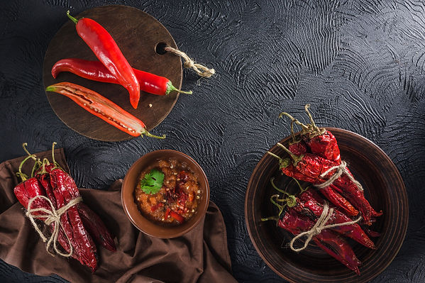 Spicy chili on a dark background in cera
