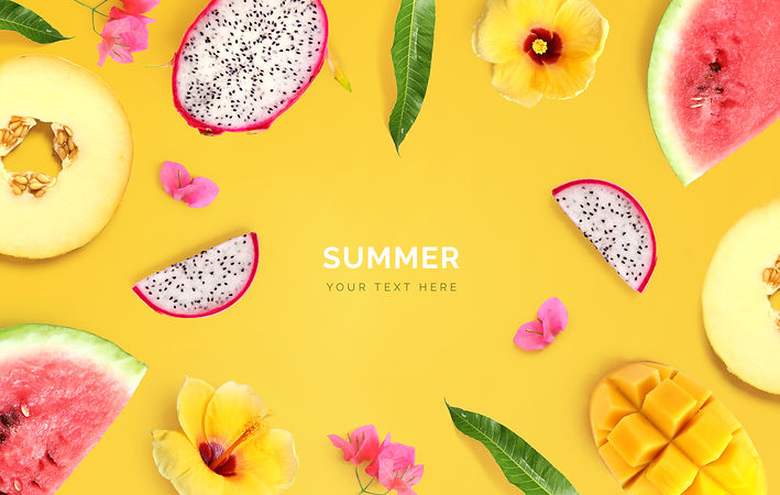 Creative layout made of melon, watermelon, dragon fruit, mango and flowers on yellow backg
