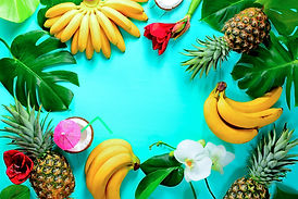 Summer colorfull concept with tropical fruits and flowers, flat lay, space for a text.jpg
