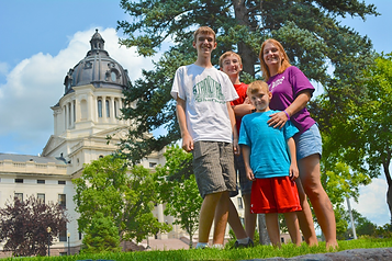 Lia Blanchard, freelance business writer, with her sons at the North Dakota state capitol.