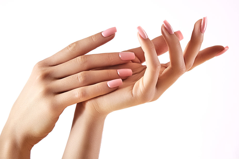 Beautiful woman's hands on light backgro