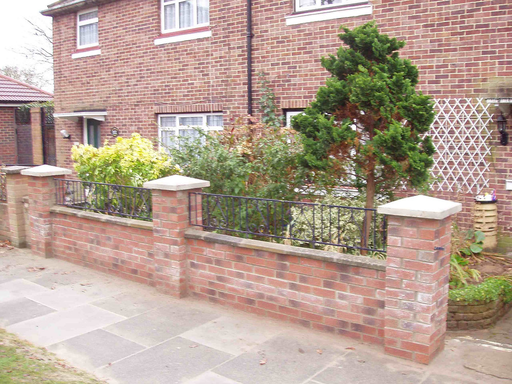 Stephen Charles Landscaping brick wall with iron rail inserts