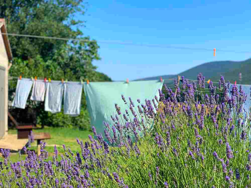 clothes hanging to dry outside a small village house on The Way of the Silent Villages in Umbria, Italy