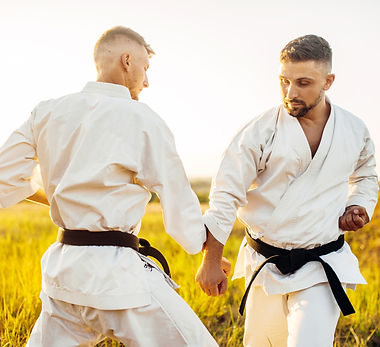 two-karate-fighters-on-outdoor-training-