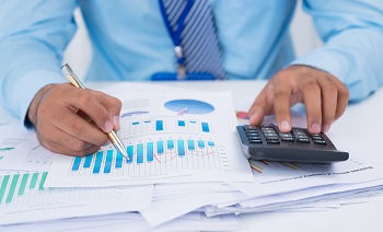 Financial manager analyzing charts and g
