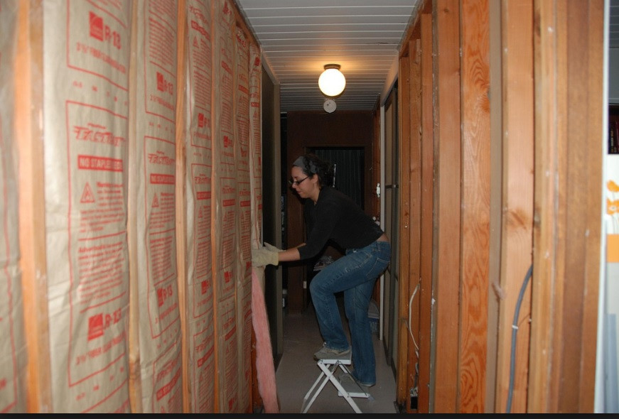 Lady setting up her home insulation