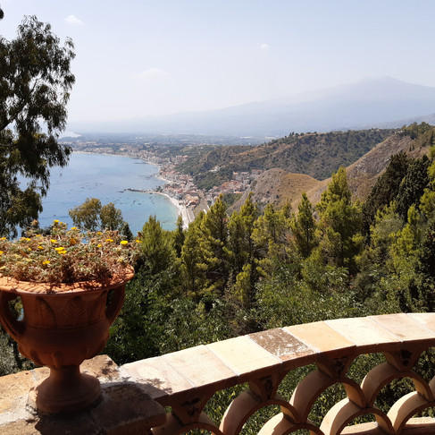 Sicily - The beautiful Taormina at the foot of the majestic Mount Etna