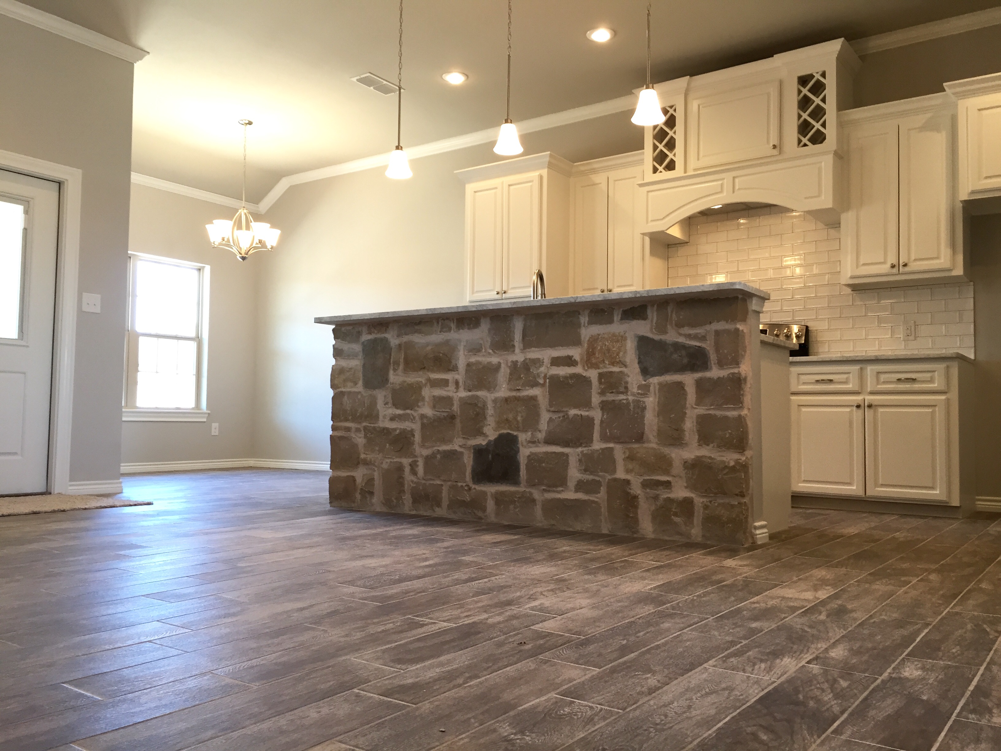 custom home | rock | kitchen | tile