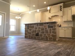 custom home | rock | kitchen | tile