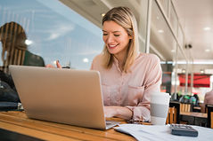 young-businesswoman-working-on-her-lapto