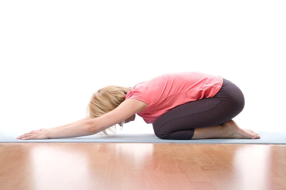 Woman doing child's pose stretch