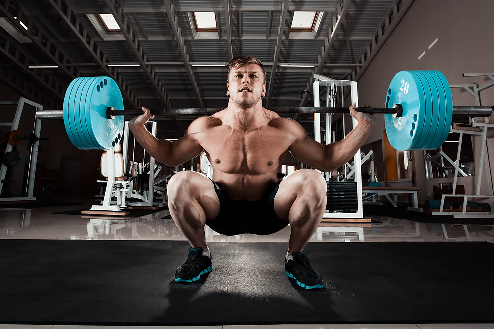 Man performing deep back squat