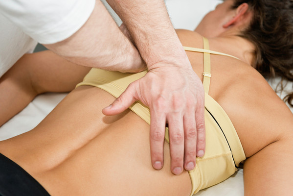 Chiropractic adjustment being performed