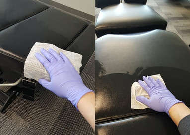 wiping down the chiropractic table at In