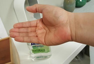 Using hand sanitizer at Integrity Chirop