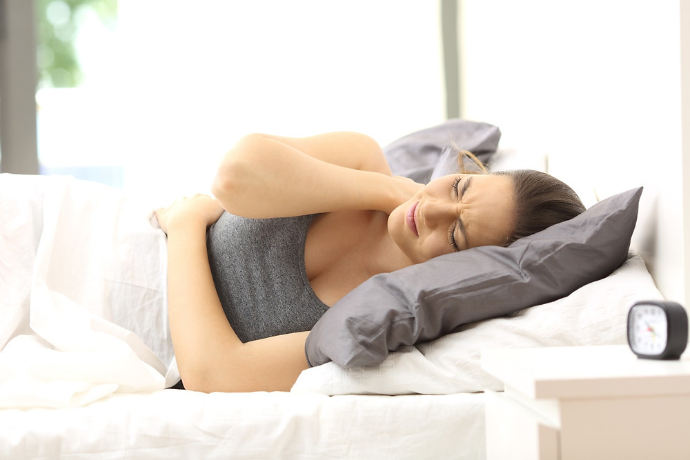 Woman waking with neck pain