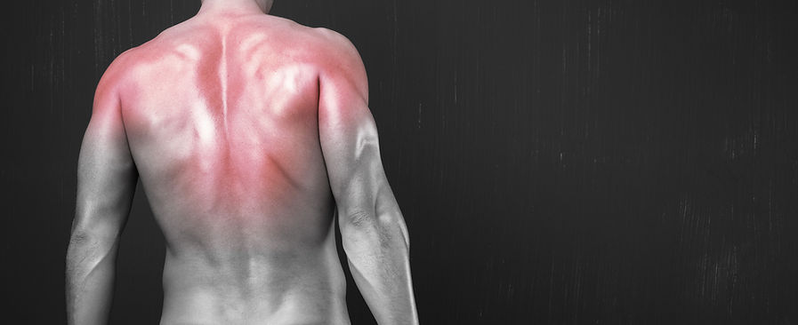 Athlete with sore back muscles
