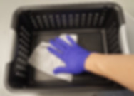 Wiping down the item basket at Integrity