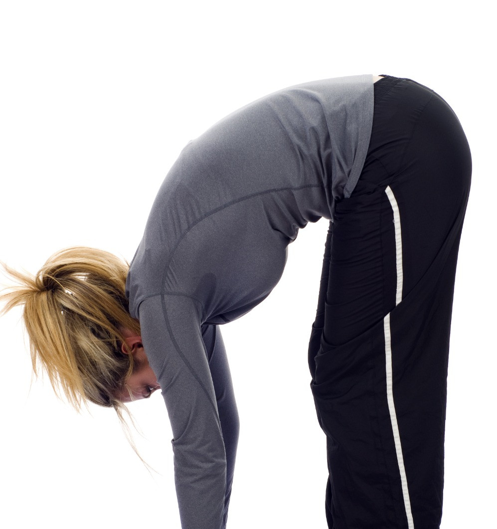 Woman bending forward with good low back mobility