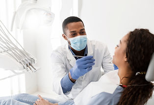African american male dentist making tre