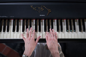 Yamaha Piano & Louise Campion's hands