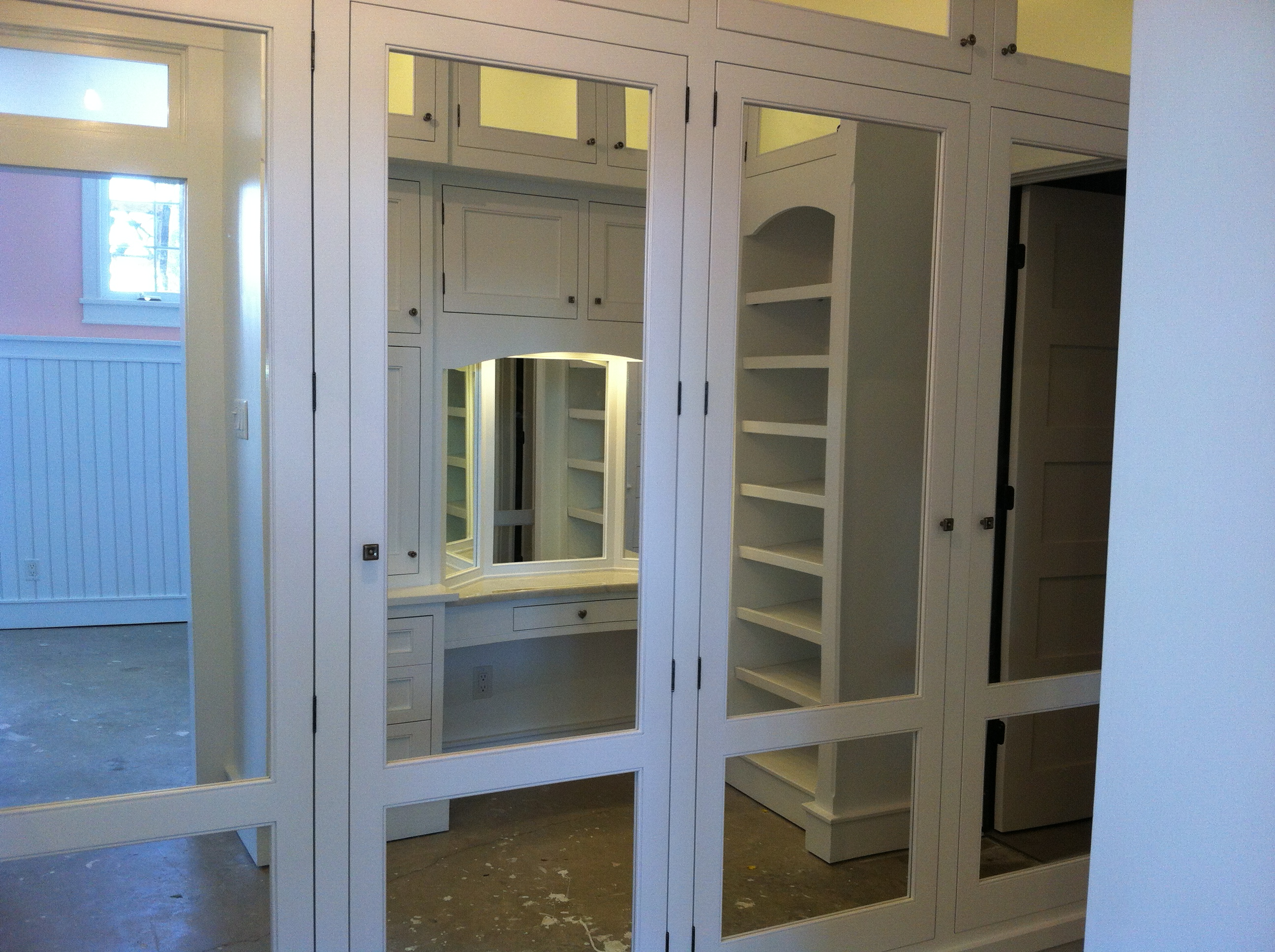 closet with mirrored doors