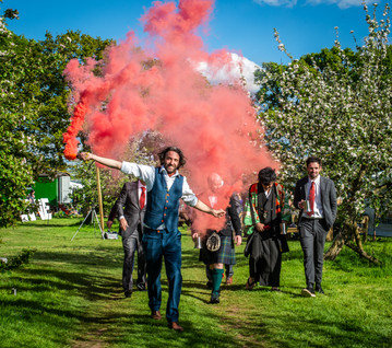 Tom and his groomsmen setting off flares