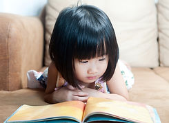 Asian little girl reading her book, educ