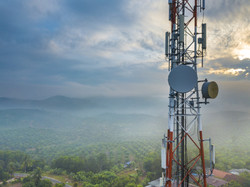 Aerial view of telecommunication tower with sunrise background