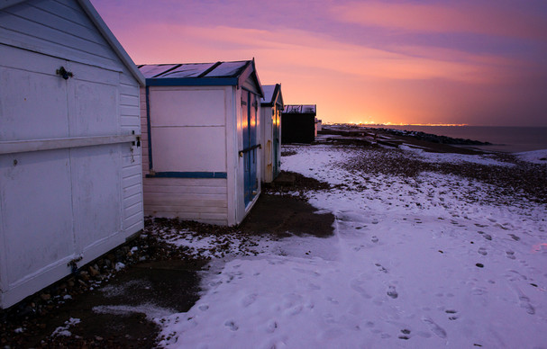 Beach Huts and sunset