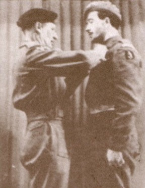 Photo of Maxwell being celebrated as a war hero