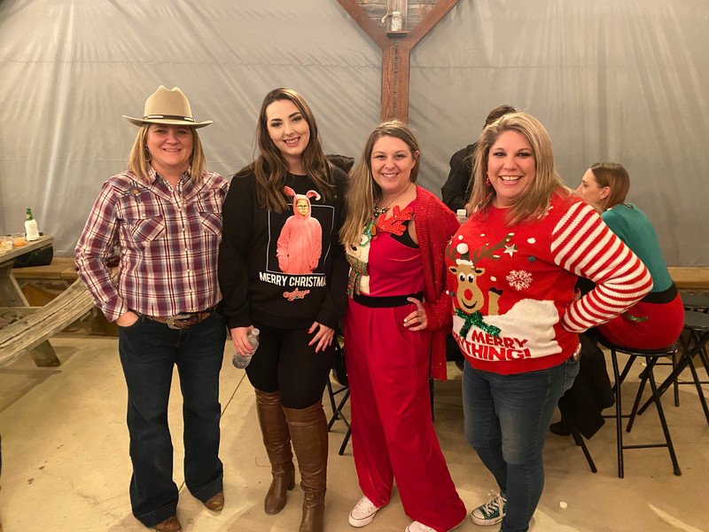 A few of our Corporate office ladies at the annual Christmas party.