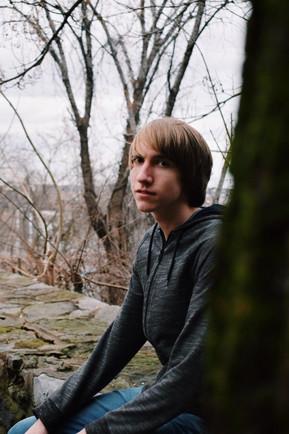 Jacob at tree looking at camera.JPG