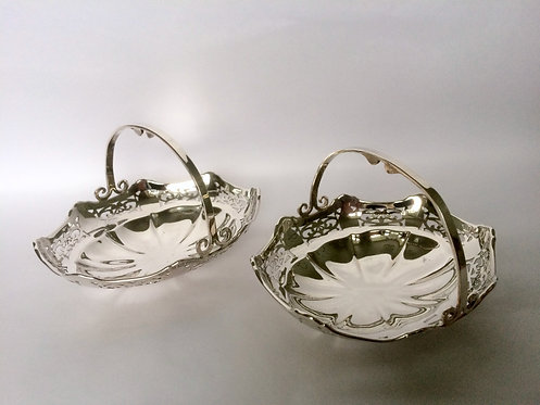 A pair of pierced silver sweetmeat baskets.