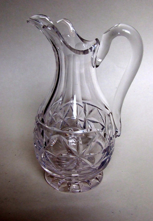 A fine Victorian cut glass cream jug.