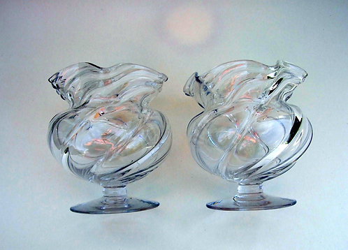 A pair of Victorian wrythen glass posy vases.
