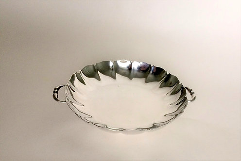 A superb twin handled silver dish.