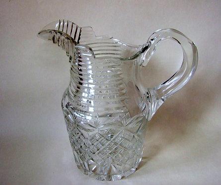 A Georgian style cut glass water jug.