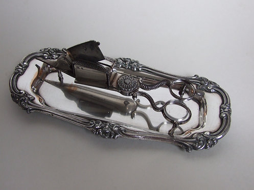 A William IV silver close plated candle snuffer